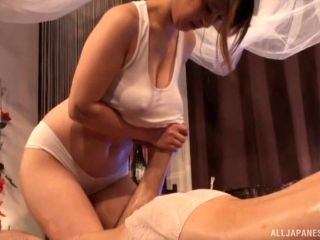 Busty massage lady giving a special Japanese treatment to her customer