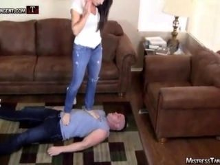 Mistress Tangent forces a guy to kiss her feet and tramples