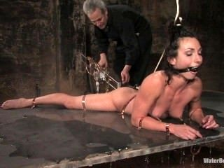 Sexy Brunette In Dungeon Eagerly Takes On Bdsm